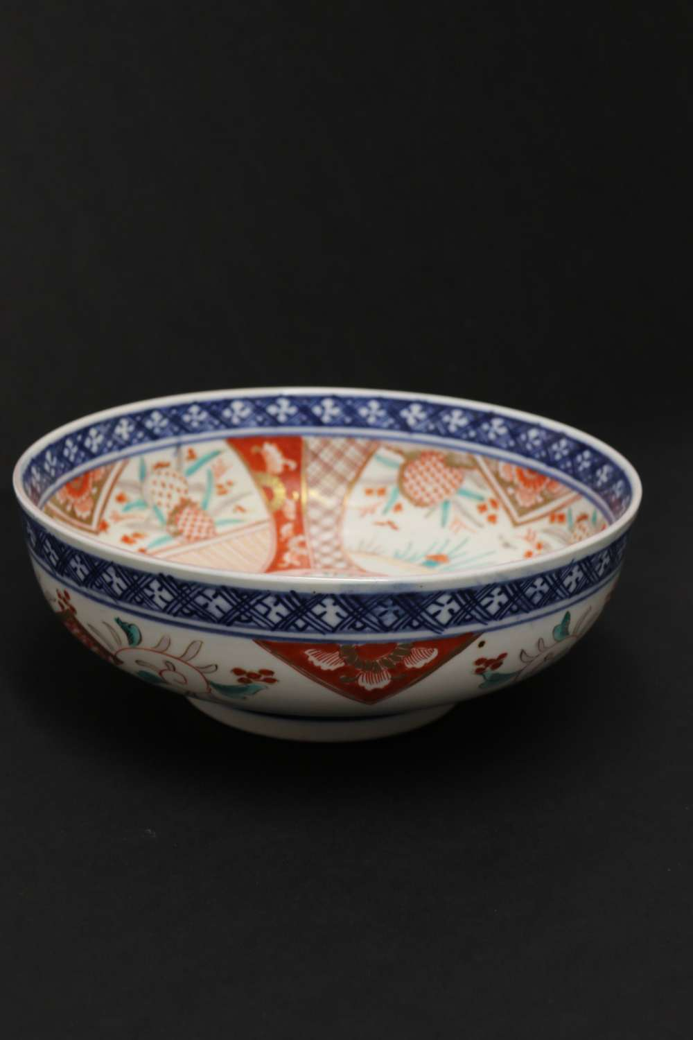 A Japanese Meiji Period Porcelain Bowl Hand Painted With An Imari Pattern Design.