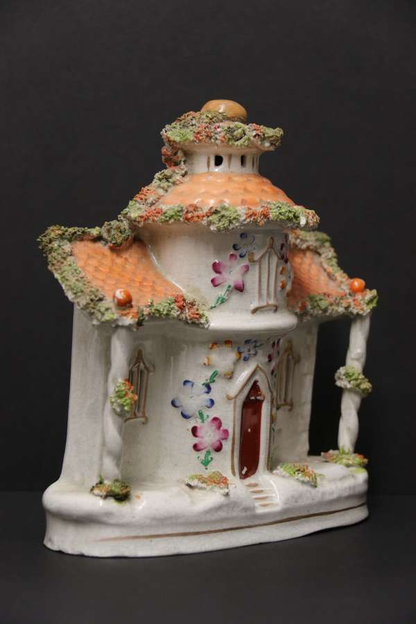 A Staffordshire Pottery Model Of An English Cottage.