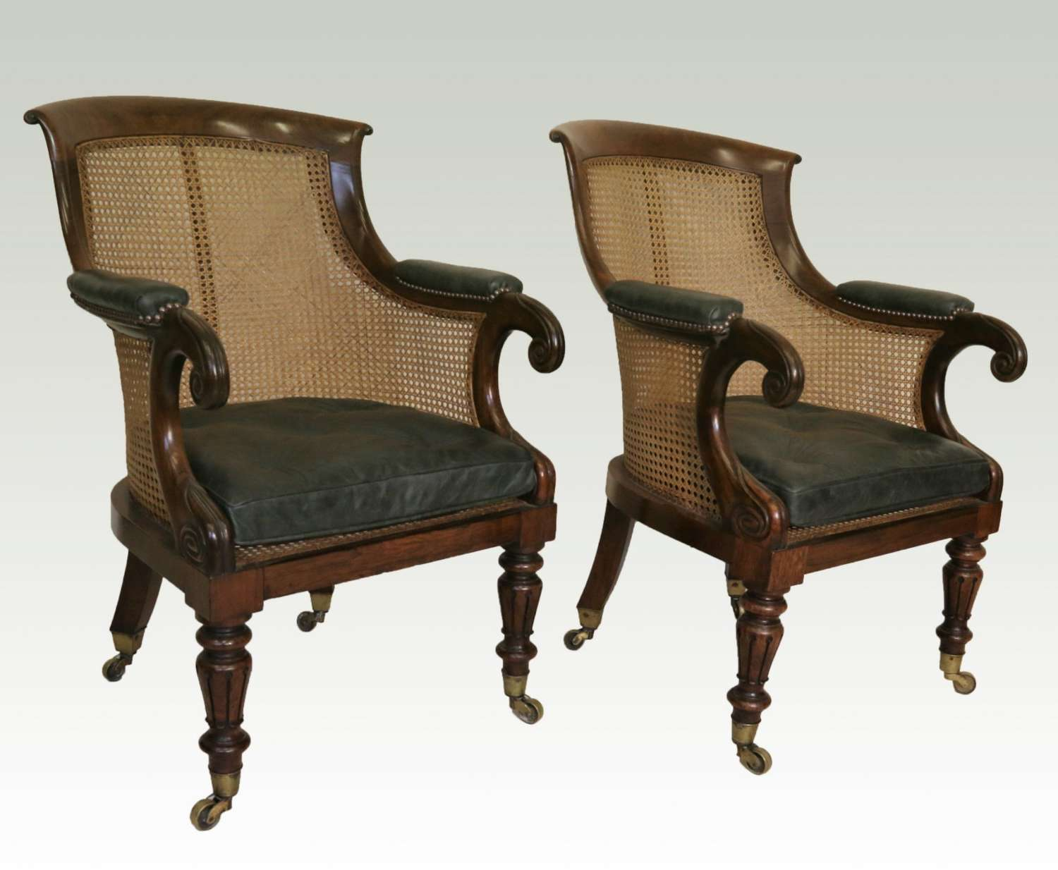 A Fine Pair Of Late Regency Carved Solid Rosewood Bergère Library Arm Chairs.