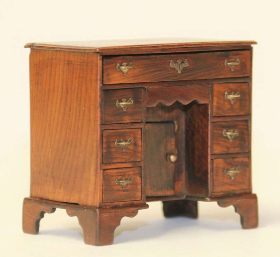 A Miniature Small Scale Model Of A Yew Wood Kneehole Desk, Circa 1910