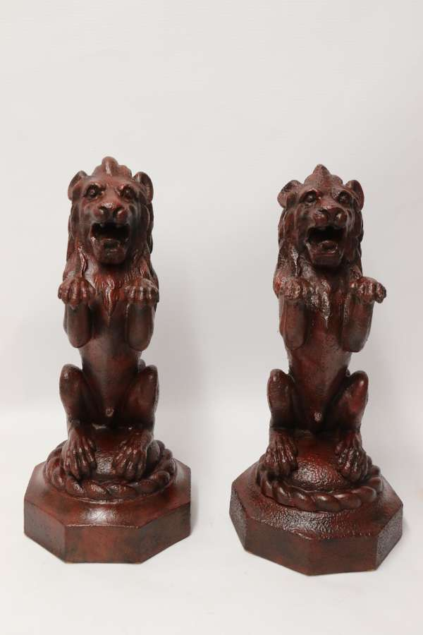 A Pair Of Regency Period Cast Iron Lion Doorstops