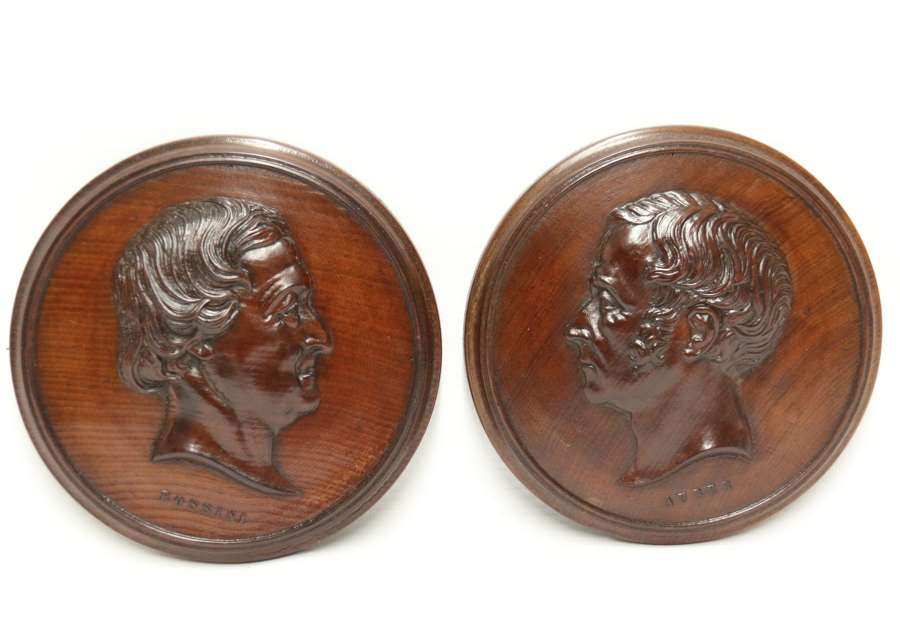 A Very Fine Pair Of Mid 19th Century Carved Mahogany Portrait Wall Plaques  The Composers Rossini And Auber