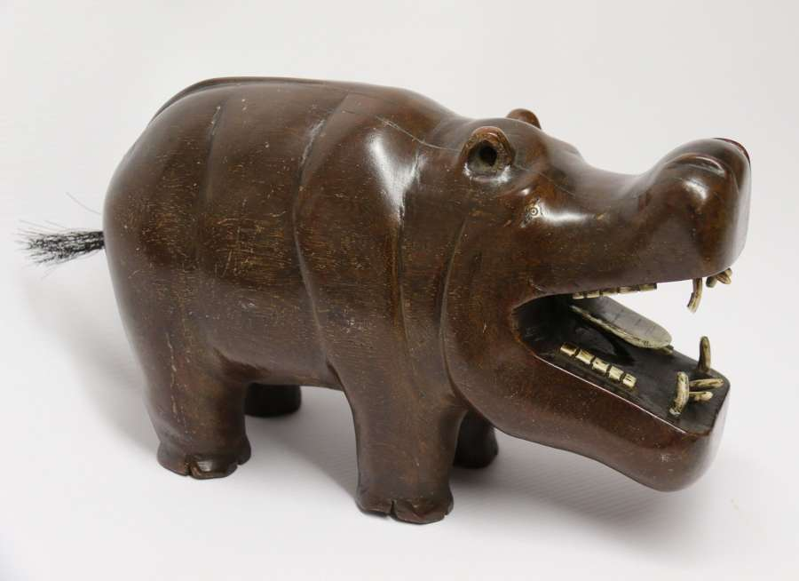 A Rare African Carved Hardwood And Bone Study Of A Hippopotamus