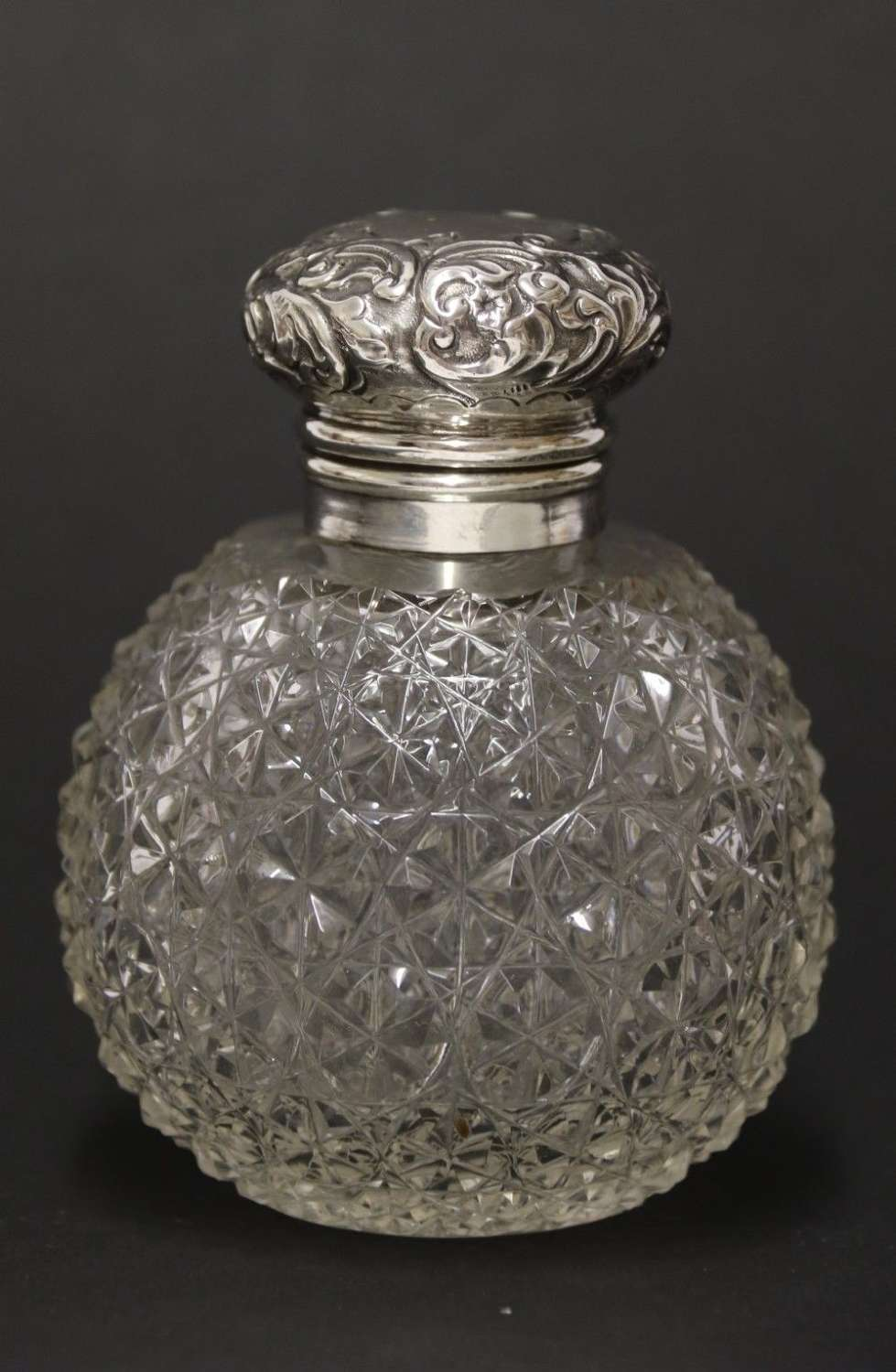 A Good Quality Victorian Silver And Cut Glass Perfume Bottle