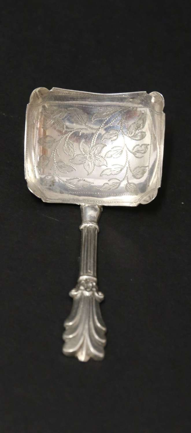 An Antique Early Victorian Silver Caddy Spoon With A Rectangular Bowl With Foliate Engraving.