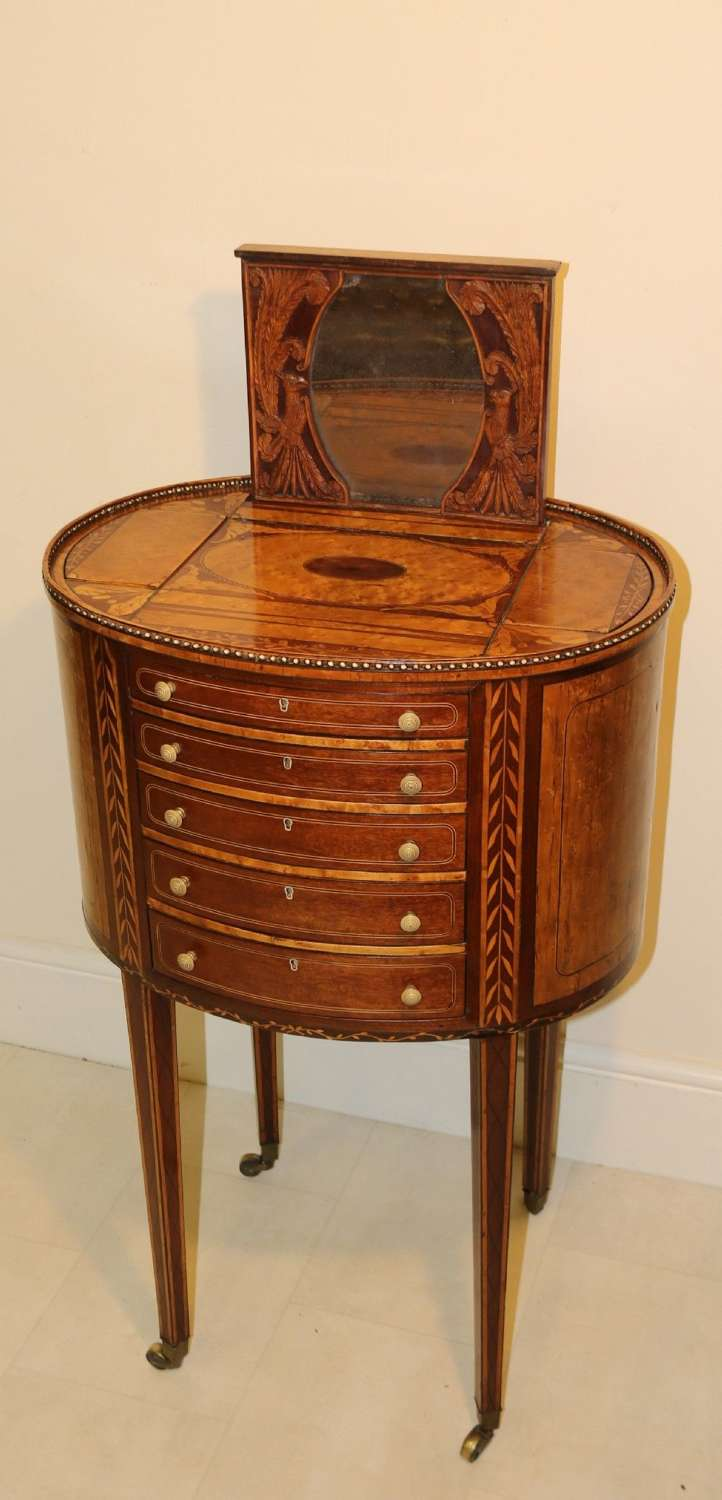 A Rare And Exquisite George III Ladies Worktable With Multiple Secret Rising Compartments.