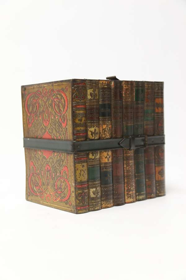 A Victorian Huntley And Palmer Biscuit Tin In The Form Of A Group Of Books