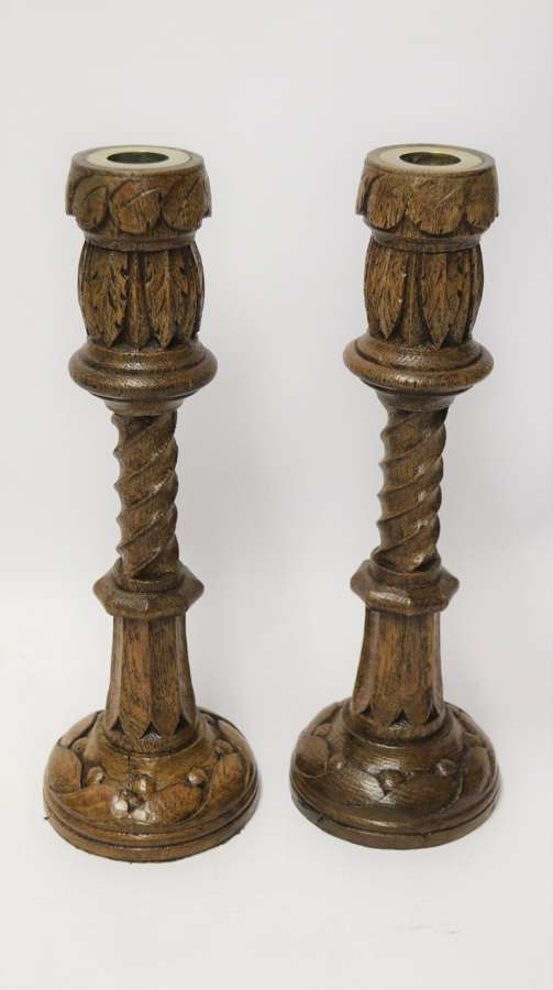 A Fine Pair Of English Victorian Carved Oak Gothic Revival Candlesticks.