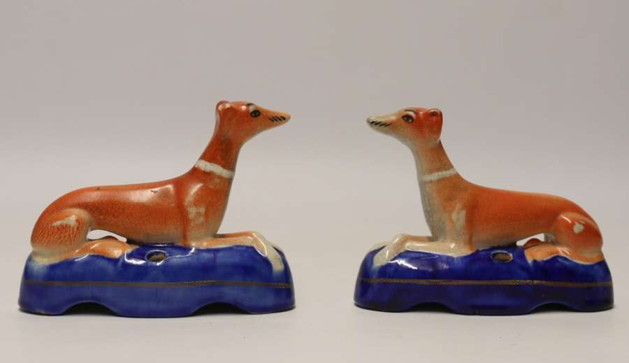 A Pair Of English Staffordshire Pottery Grey Hound Dogs. Mid 19th C