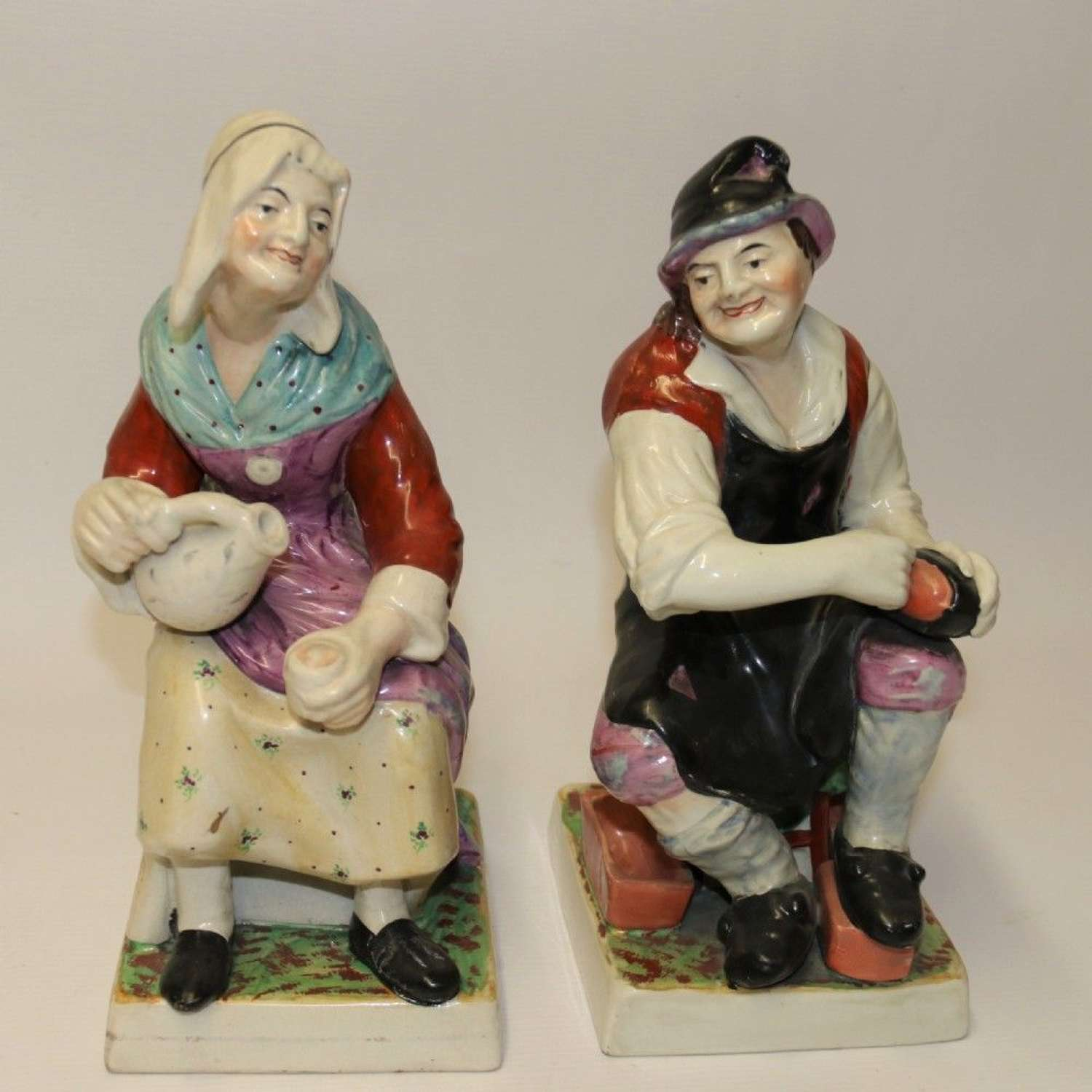 A Large Pair Of  19th C Staffordshire Pottery Seated Figures.