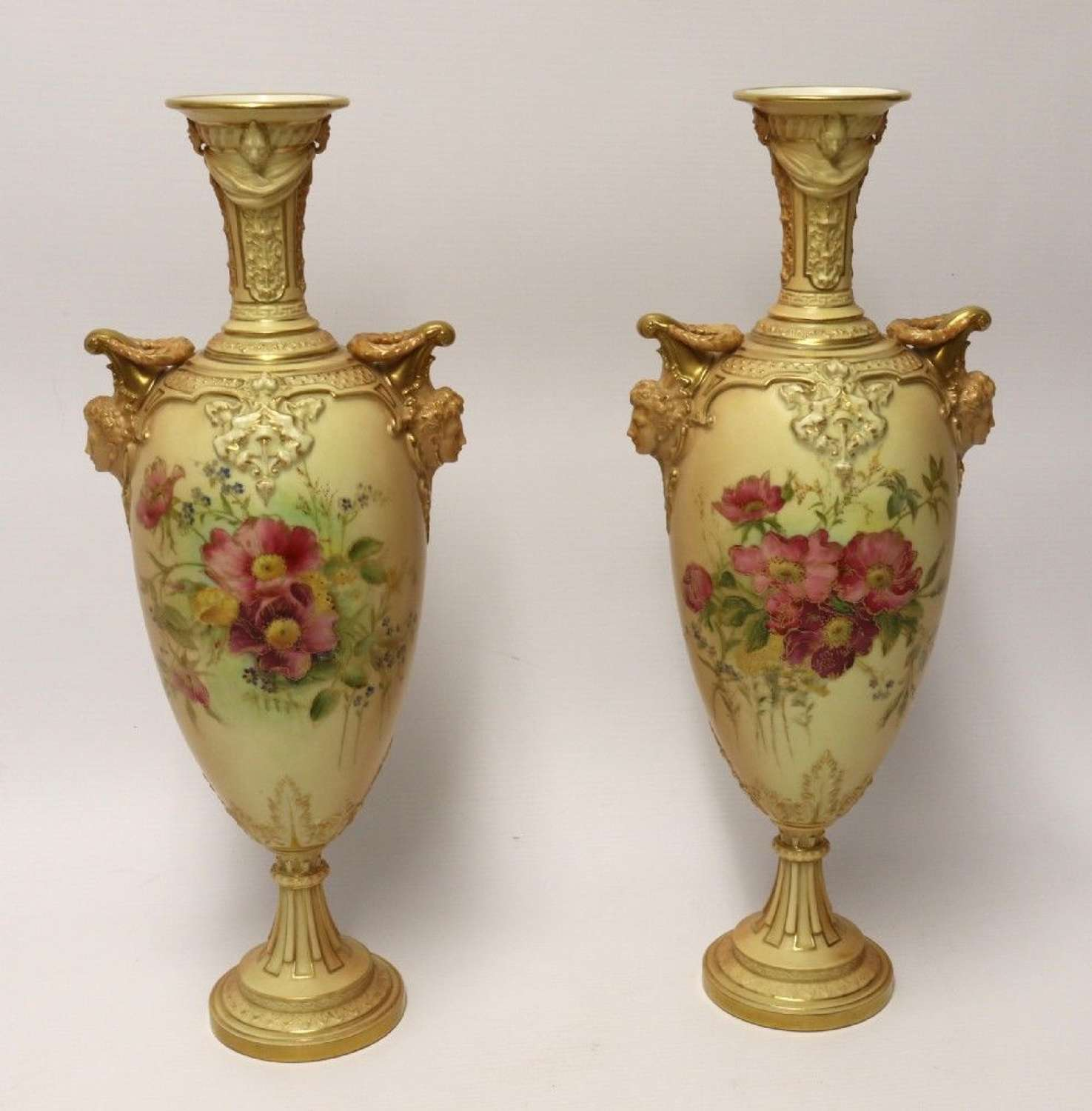 A Large Pair Of Antique Royal Worcester Hand Painted Blush IVory Pedestal Vases.