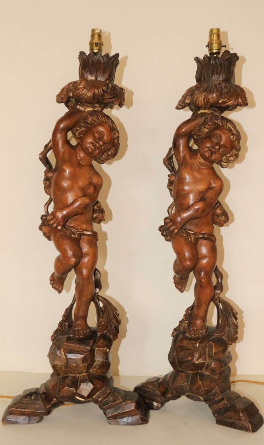 A Large Pair Of Carved Wooden Cherub Lamps