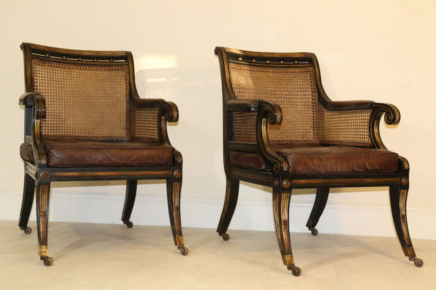 A Superb Pair Of Bergère Library Chairs.