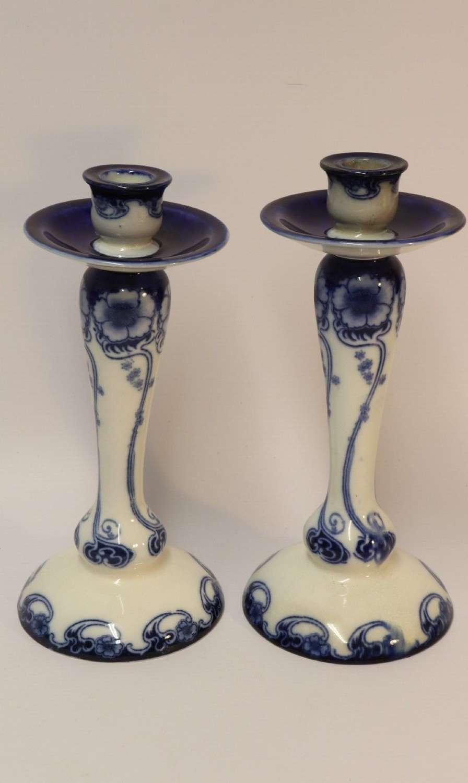 A Pair Of Art Nouveau Pottery Candle Sticks