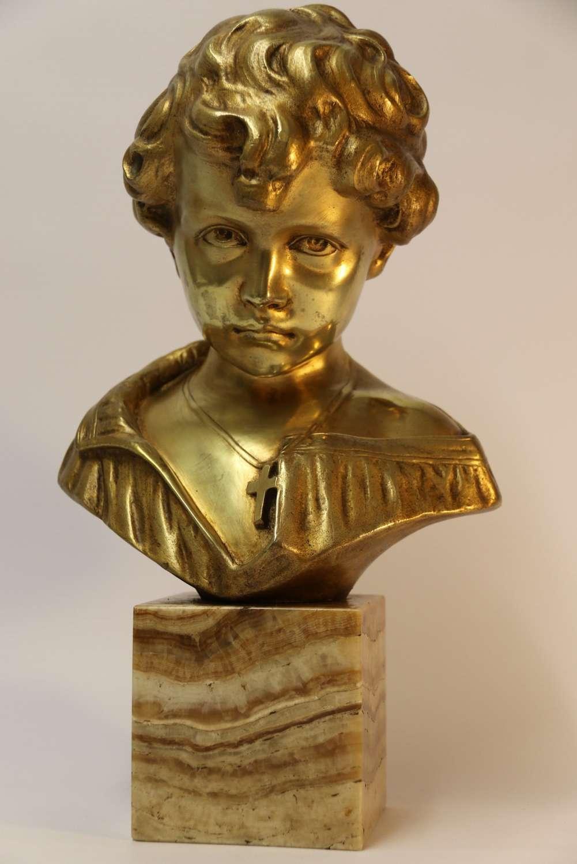 A Gilt Bronze Bust Of A Boy After Donatello