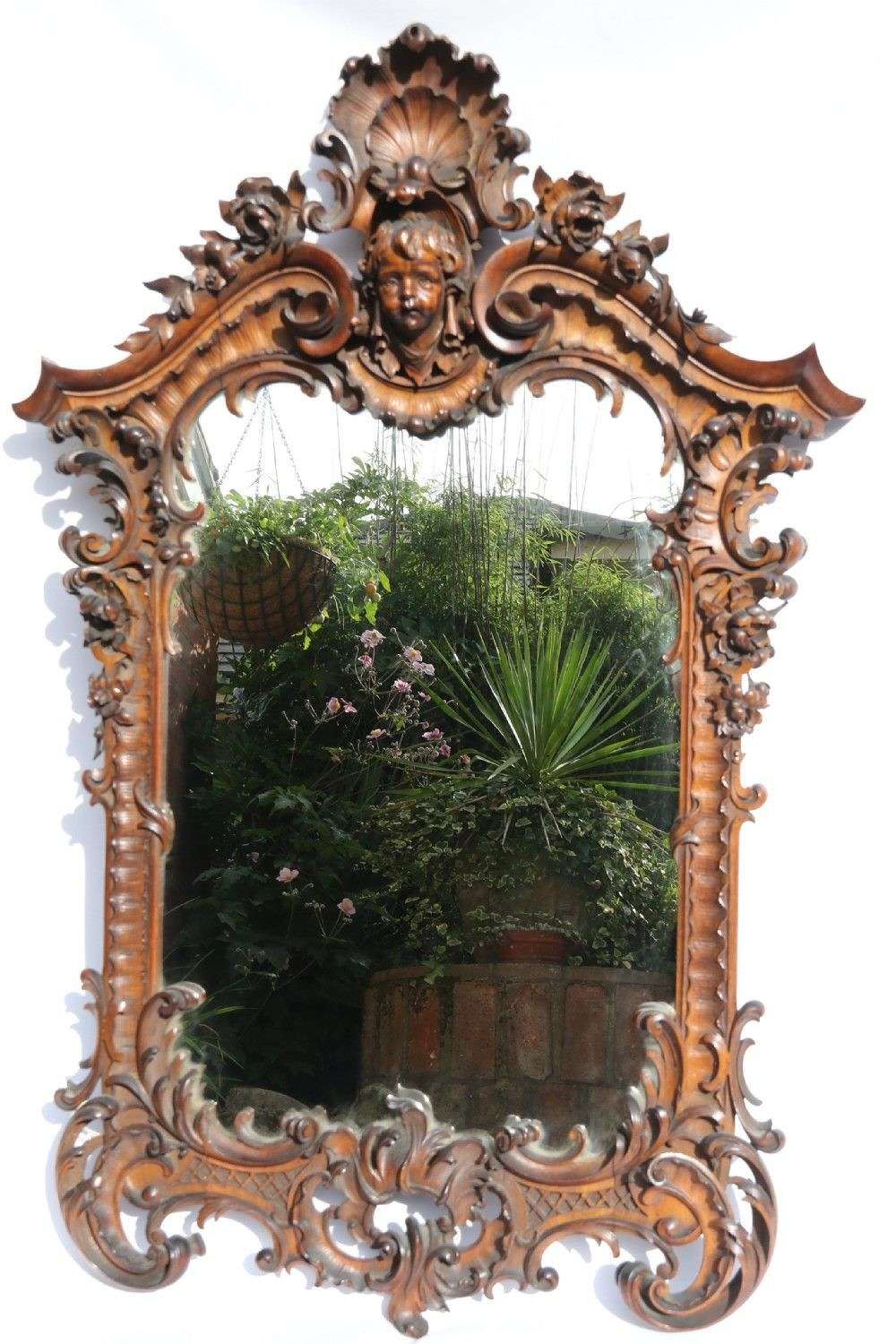 An Exquisitely Carved 19th Century Italian Walnut Mirror