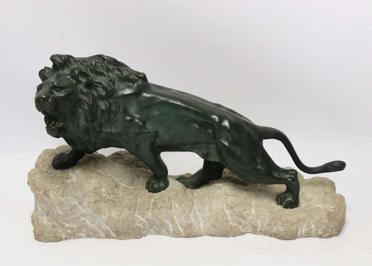 Early 20th Century Bronze Study Of A Lion Mounted On Limestone Base