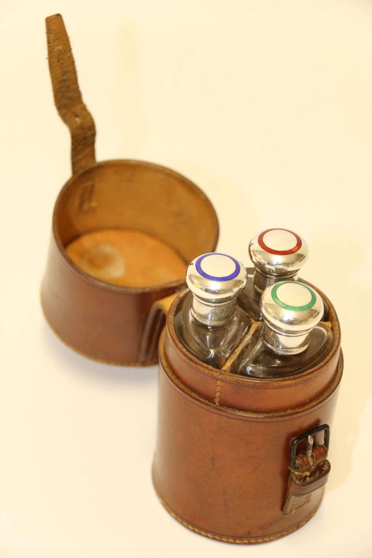 A Set Of Cased Hunting Flasks