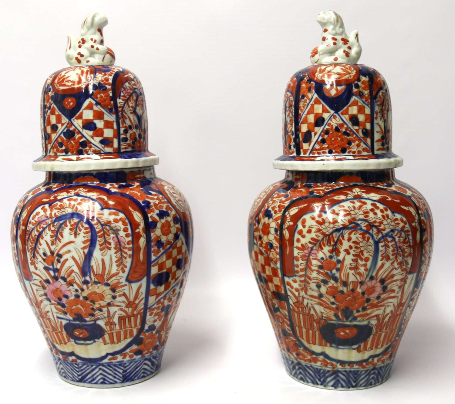 A Large Pair Of Japanese Imari Ginger Jars With Covers