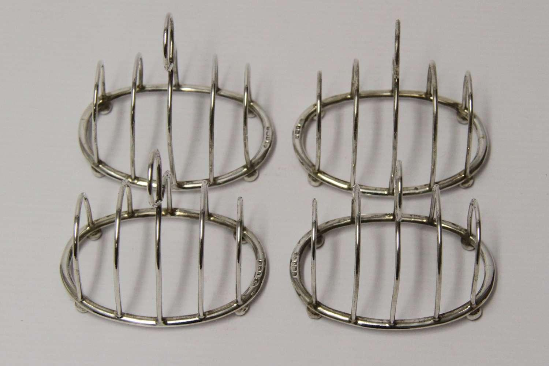 A Rare Set Of Four Silver Toast Racks