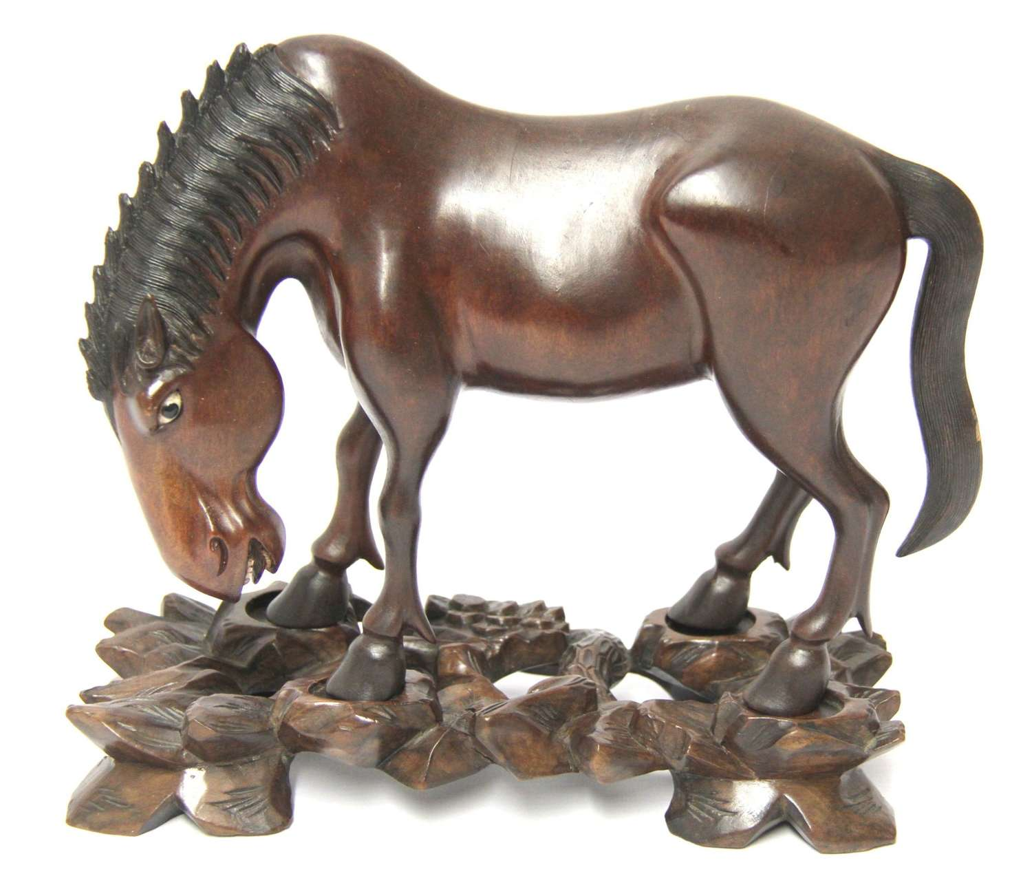 A 19th Century Chinese Carved Hardwood Study Of A Horse