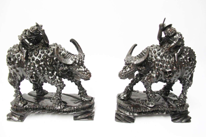 A Pair Of Chinese Hardwood Buffalo