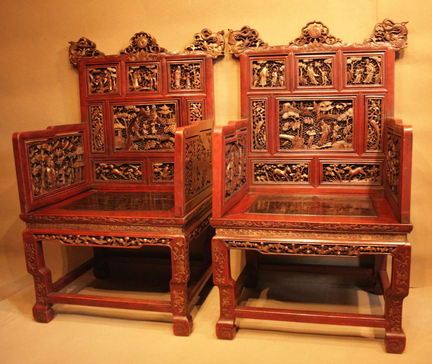 A  Highly Decorative Pair Of Chinese Throne Chairs