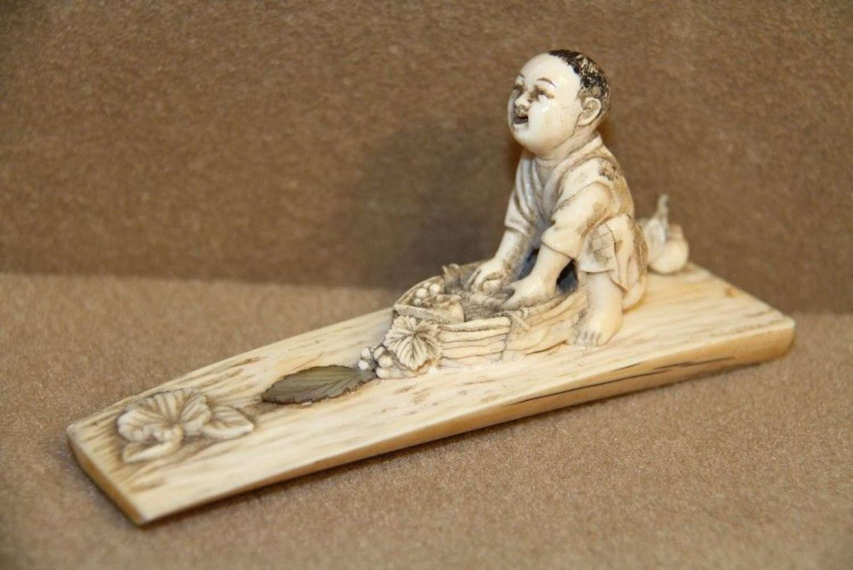 A Japanese Meiji Period Carved IVory Okimono