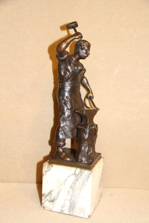A Bronze Study Of A Blacksmith