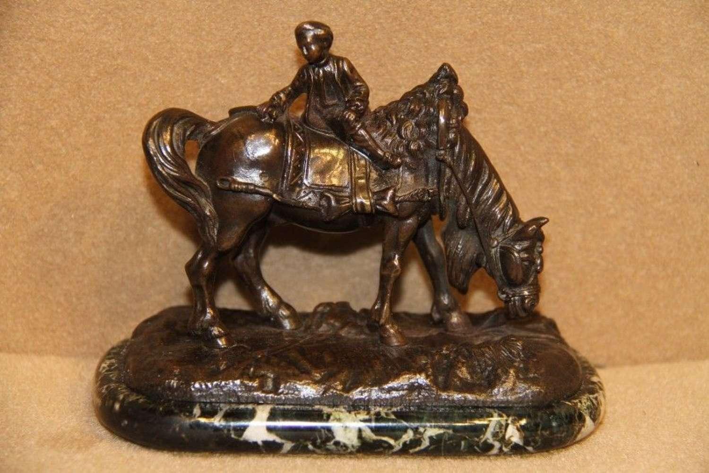A Miniature Bronze Figure Of Carriage Horse