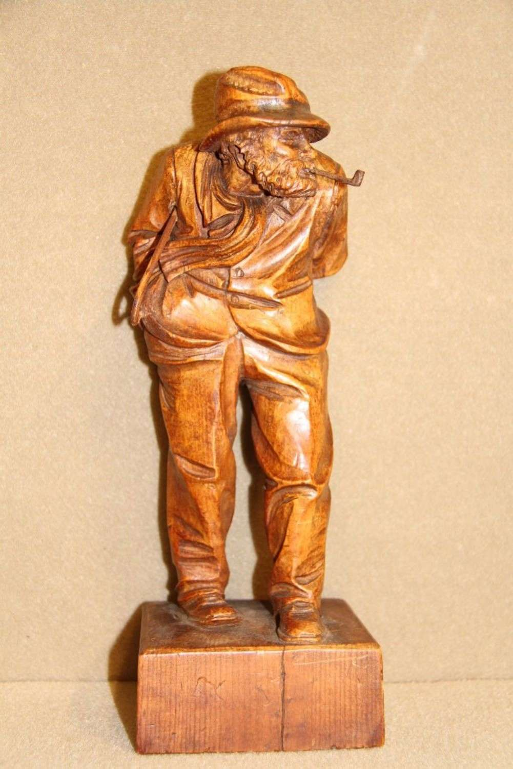 A Carved Pine Study Of A Windswept Gentleman