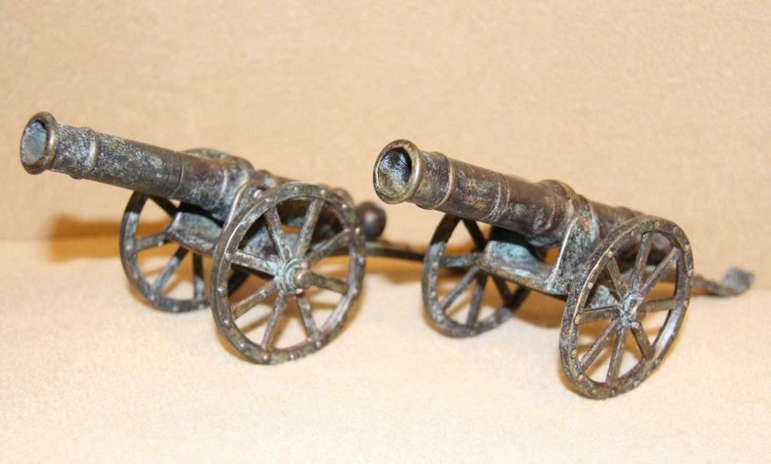 A Pair Of Bronze Cannons