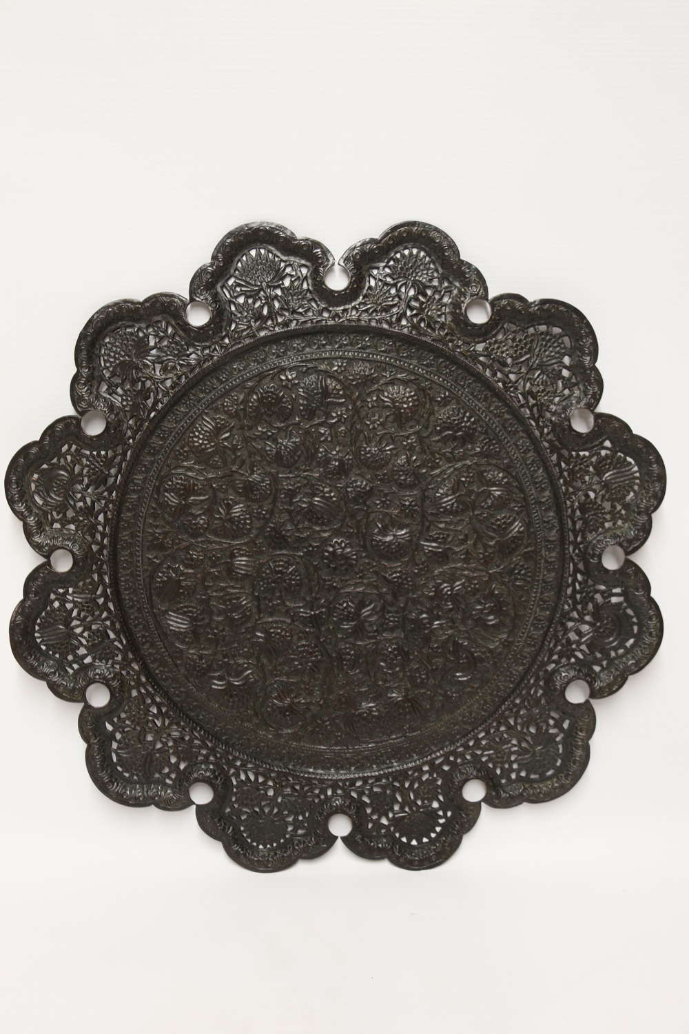 An Indian Raj period copper hand pierced and decorated wall charge