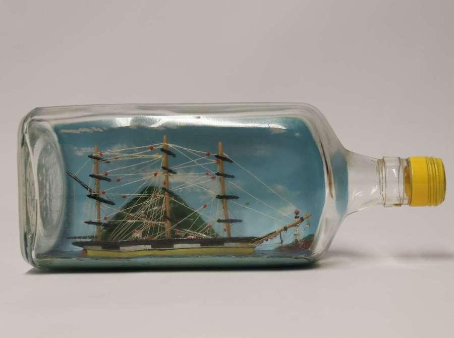 A Fine Diorama folk art model ship in a bottle