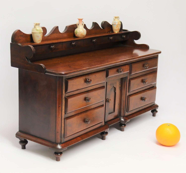 A rare miniature mid 19th century mahogany dresser base, Victorian