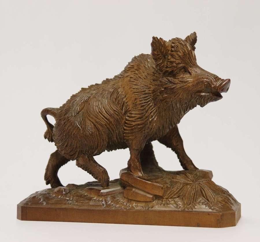 A fine Black Forest limewood carved study of a boar, Circa 1870