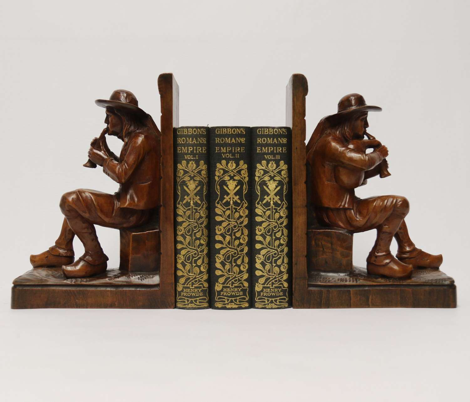 A fine pair of Black Forest carved walnut bookends, circa 1900