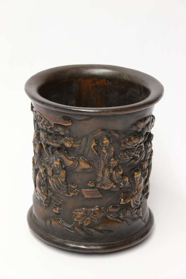 A Chinese carved bamboo and hardwood brush pot